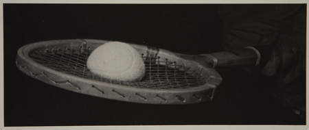 Ball hitting a racket