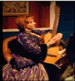 Lillie Langtry (Jane Barnes Doherty) playing her vintage guitar