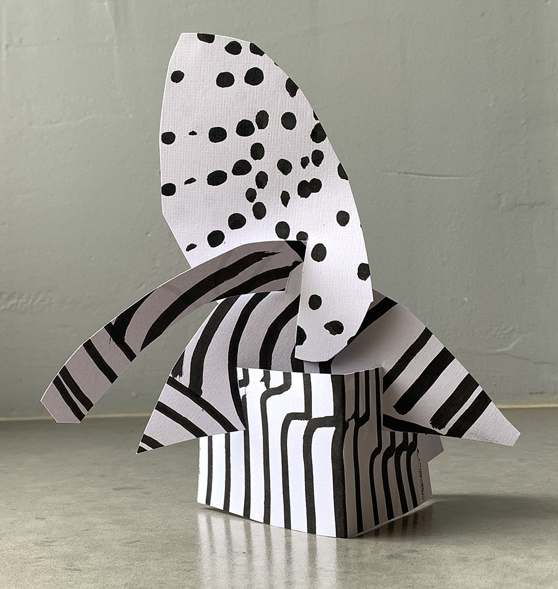 Make a sculpture without glue or tape and a drawing tool using items you have at home.