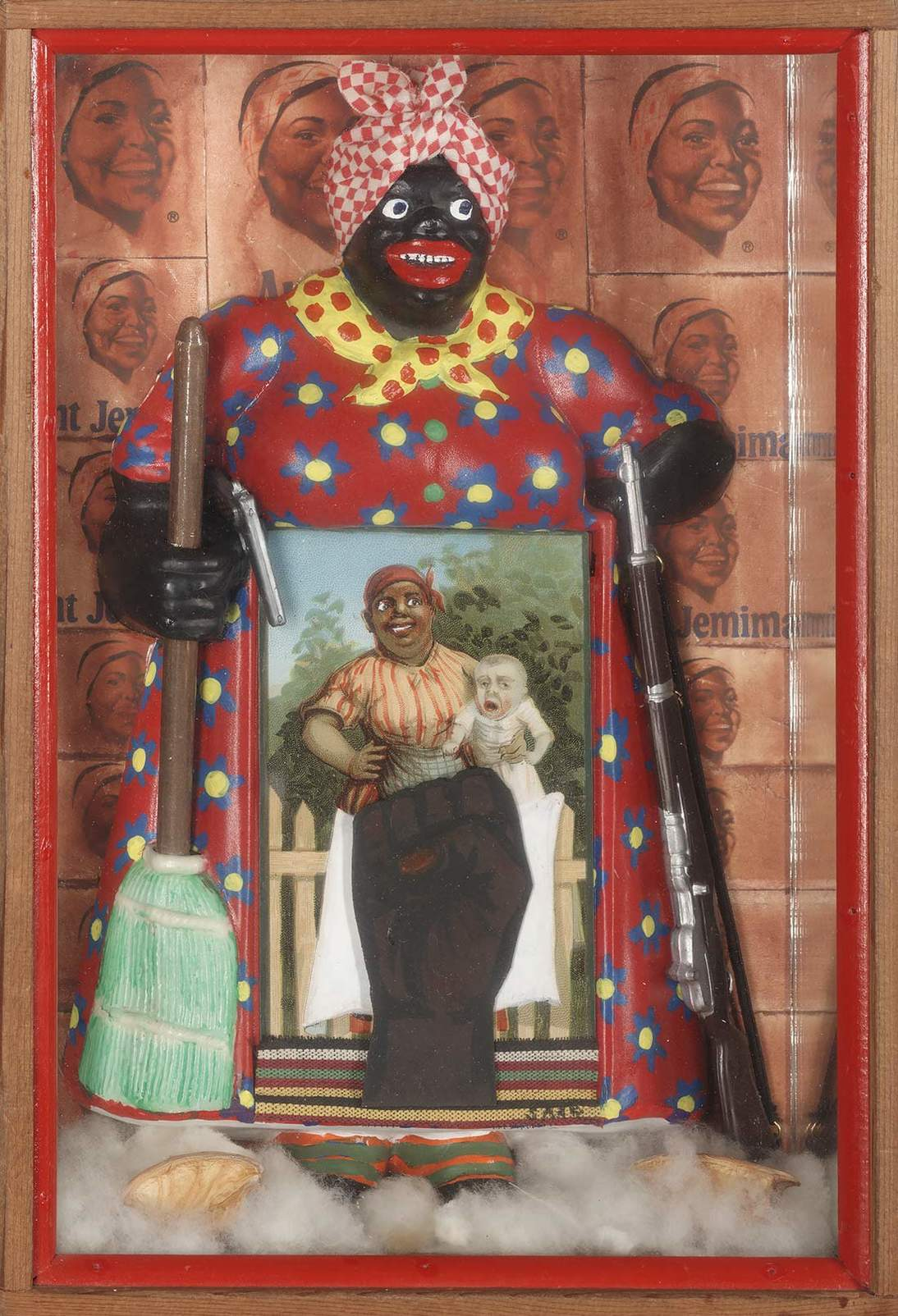"""Betye Saar, """"The Liberation of Aunt Jemima,"""" 1972. Wood, cotton, plastic, metal, acrylic paint, printed paper and fabric,  11.375 x 8 in. (29.8 x 20.3 cm). Collection of Berkeley Art Museum and Pacific Film Archive, Berkeley, California; purchased with the aid of funds from the National Endowment for the Arts (selected by The Committee for the Acquisition of Afro-American Art). Courtesy of the artist and Roberts Projects, Los Angeles, California. Photo Benjamin Blackwell"""