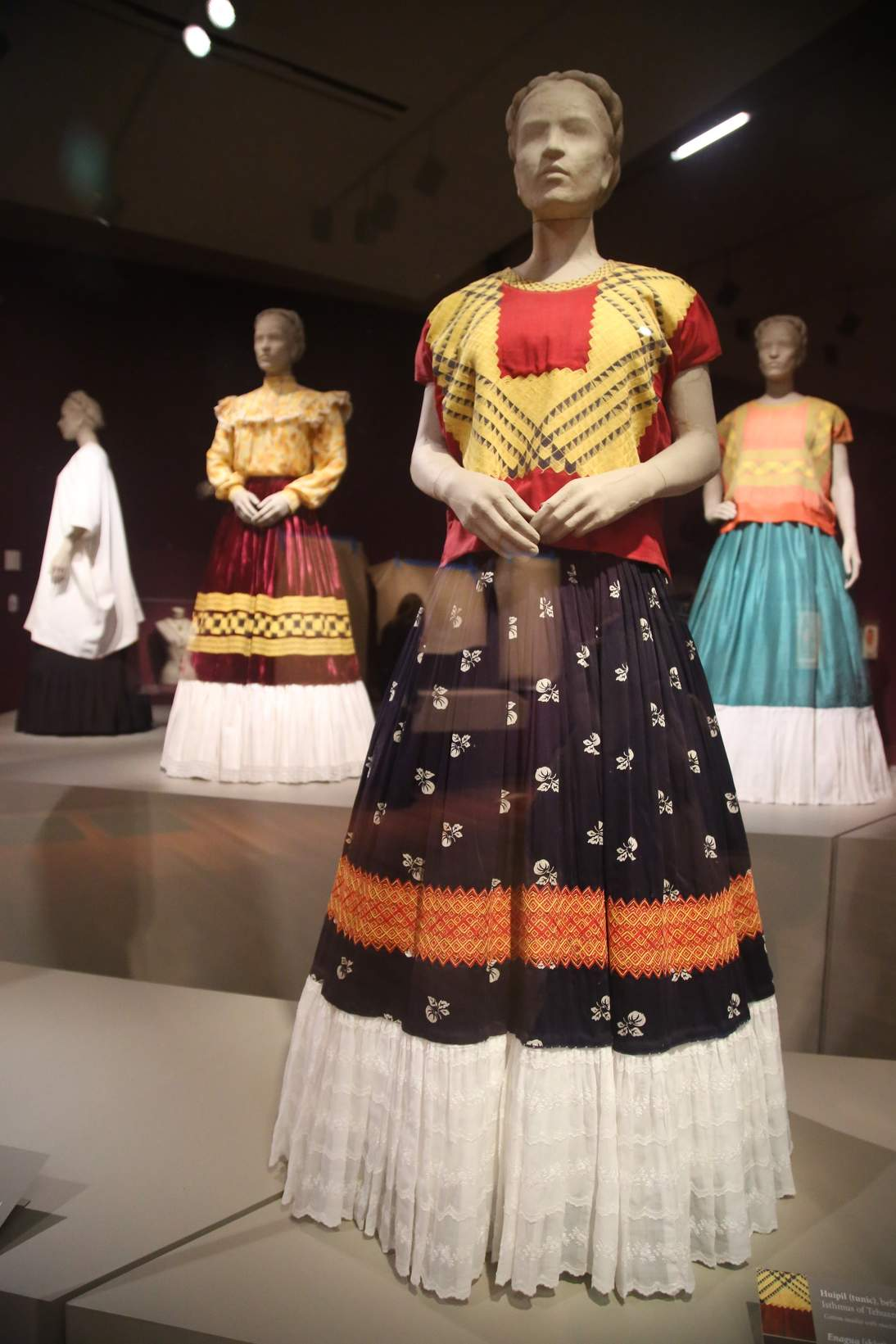 "Installation of ""Frida Kahlo: Appearances Can Be Deceiving"" at the de Young museum, with Kahlo's ensembles from the Museo Frida Kahlo."