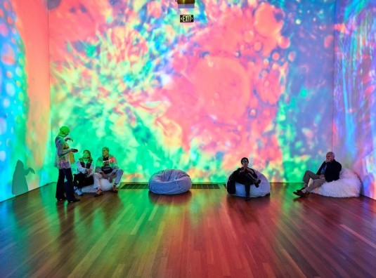 """Installation view of """"The Summer of Love Experience: Art, Fashion and Rock & Roll"""" at the de Young Museum"""