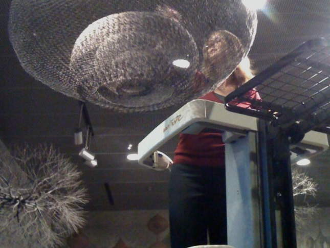 Dusting the suspended Ruth Asawa sculptures.